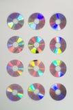12 компактных дисков в строках 3 Стоковая Фотография