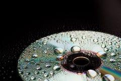 компакт-диск падает вода Стоковые Изображения RF