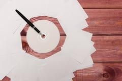 Компакт-диск и ручка Стоковое Изображение RF
