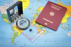 Компас и немецкая карта пасспорта и мира Стоковая Фотография RF