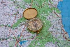 Компас и туристская карта Украины outdoors стоковое фото rf