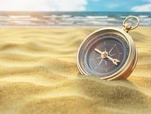 Компас на песке моря Назначение перемещения и концепция навигации стоковая фотография