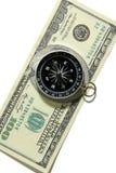 Компас на предпосылке банкнот Стоковое Изображение