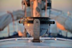 Компас на яхте во время захода солнца Стоковая Фотография