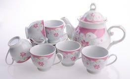 Комплект бака чая, чай фарфора бак и чашка на предпосылке Стоковые Фотографии RF
