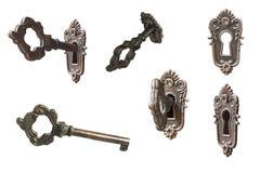 Комплект винтажного изолированных ключа и отверстия для ключа в белизне Стоковая Фотография