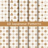 Комплект 10 золотых японских безшовных картин вектора с цветком конструирует дизайн для упаковки, крышек, ткани Стоковое Изображение