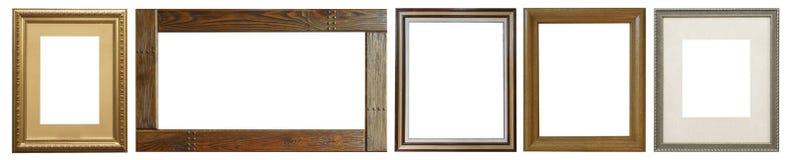 Комплект изолированных рамок искусства пустых в золотом стоковая фотография