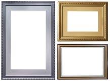 Комплект изолированных рамок искусства пустых в золотом стоковые изображения