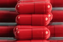 Комплект красных пилюлек в пакете Стоковое Фото