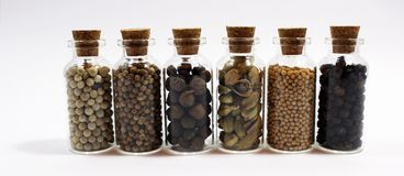 Комплект малых получателей заполненных с condiments Стоковое Фото