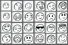 Комплект 24 нарисованных рук doodle усмехается на странице тетради вектор Стоковое Фото