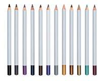 Комплект пестротканого косметического карандаша для состава изолировал белую предпосылку Стоковые Изображения