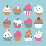 Комплект пирожных на голубой предпосылке иллюстрация штока