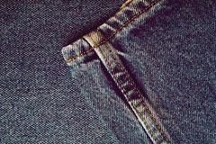 Комплект предпосылки джинсов джинсовой ткани различных выборов стоковая фотография