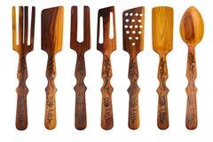 Комплект различных деревянных ложек на белой предпосылке изолировано Стоковое Фото