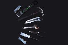 Комплект различных инструментов на черной предпосылке Стоковое фото RF