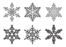 Комплект различных снежинок зимы на белой предпосылке Стоковое Фото