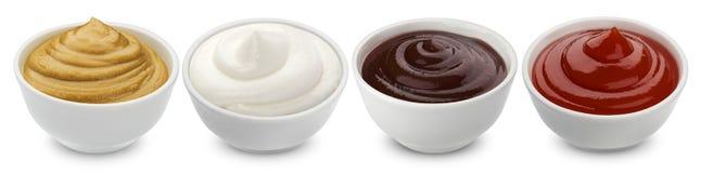 Комплект различных соусов изолированных на белой предпосылке Стоковая Фотография RF