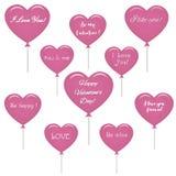 Комплект розовых воздушных шаров в форме сердца с текстом о влюбленности Стоковое Изображение