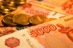 Комплект русского рубля чеканит класть на русские банкноты Русский конец валюты вверх Стоковая Фотография RF