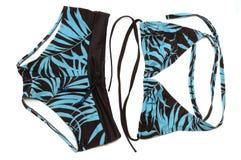 Комплект света - синь и чернота покрасили дам плавая шорты и trikini с картинами лист стоковая фотография rf