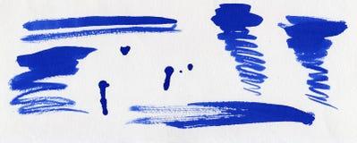 комплект синих чернил помарками Стоковое Изображение RF