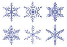 Комплект снежинок вектора на белой предпосылке Стоковые Фото