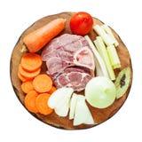 Комплект сырцовых продуктов на деревянной разделочной доске стоковое фото
