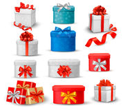 Комплект цветастых коробок подарка с смычками и тесемками. Стоковые Изображения