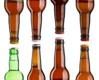 Комплект шей пивной бутылки с крышками Стоковые Фотографии RF
