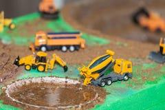 Комплект backhoe игрушки, работая в шахте стоковые фото