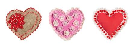 Комплект 3 handmade сердец на земле задней части белизны Стоковая Фотография