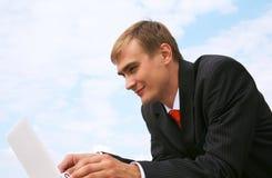 компьтер-книжка бизнесмена Стоковая Фотография