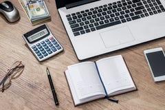 Компьтер-книжка, доллар ручки тетради, телефон Стоковое Изображение RF
