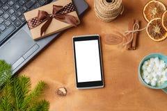 Компьтер-книжка и телефон с пустым экраном для рекламы рождества сезонной Стоковая Фотография