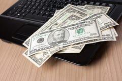 компьтер-книжка клавиатуры доллара кредиток Стоковое Изображение