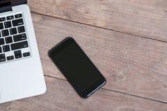 Компьтер-книжка компьютера и умный телефон стоковые изображения rf