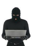 компьтер-книжка хакера преступника компьютера Стоковое фото RF