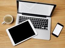 Компьтер-книжка, цифровая таблетка и мобильный телефон Стоковое фото RF