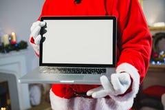 компьтер-книжка santa удерживания claus Стоковое Изображение
