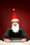 компьтер-книжка santa Стоковое Изображение
