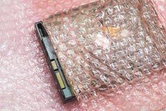 Компьютерное оборудование было создано программу-оболочку с листом воздушного пузыря стоковые фото