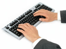 компьютер бизнесмена вручает клавиатуру s стоковое фото rf