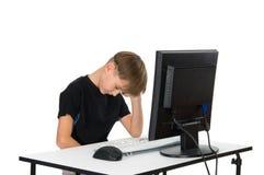 компьютер мальчика его Стоковая Фотография