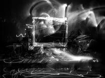 Компьютер покрашенный светом в черно-белом стоковое фото