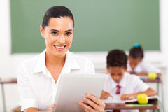 Компьютер таблетки учителя стоковое изображение rf