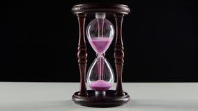 Комплекс предпусковых операций в часах Розовый песок черный сток-видео