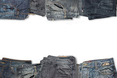 Комплекты собрания джинсов изолированные на белой предпосылке на верхней части Стоковая Фотография RF