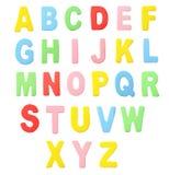Комплект алфавита древесины цвета изолированный на белизне Стоковые Фото